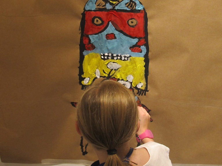 painting totem on wall